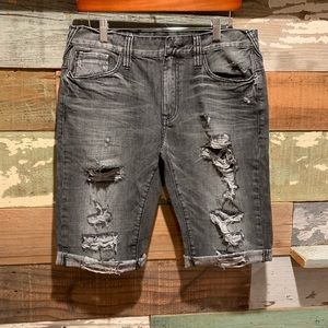 Distressed denim jean shorts by GUESS